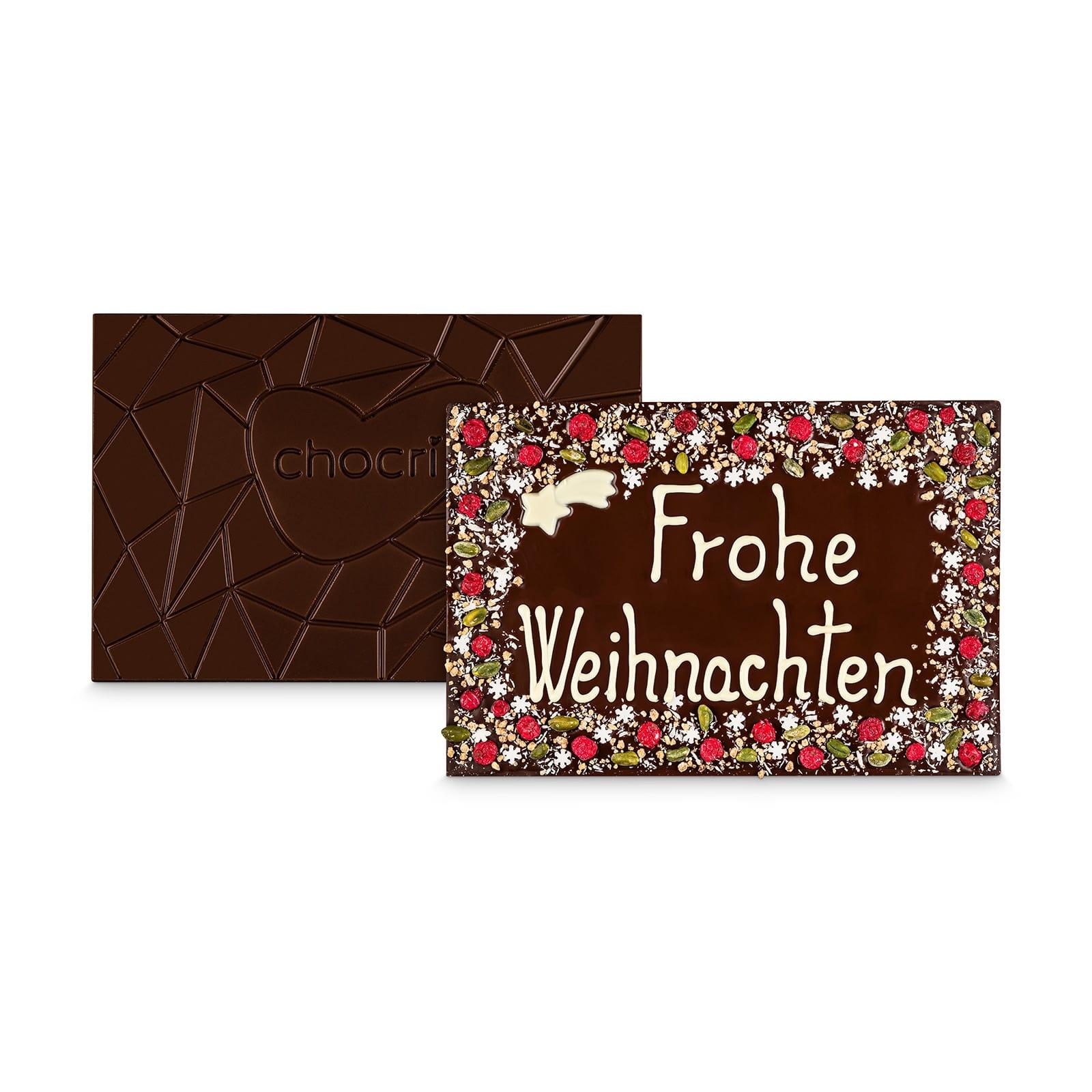 XXL Zartbitter-Schokoladentafel handbeschriftet mit 'Frohe Weihnachten' Botschaft in einer hochwertigen Holzkiste