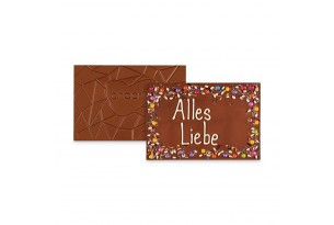 XXL Vollmilchschokoladentafel handbeschriftet mit Botschaft zum Geburtstag in einer hochwertigen Holzkiste ausgepackt