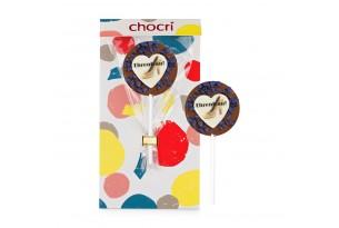 """chocri Vollnmilchschokoladen-Lolly """"Ehrenfrau""""  mit """"Ehrenfrau"""" Aufleger und Veilchenbruch in der Verpackung"""