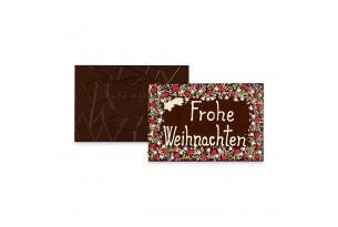 chocri 'Frohe Weihnachten' XXL-Gruß-Schokoladentafel in Holzkiste handbeschriftet und dekoriert mit Pistazien, Haselnusskrokant, Johannisbeeren und Kokos, ausgepackt mit sichtbaren Rückseite