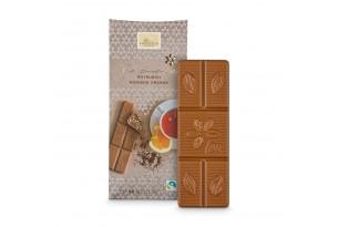 Weiße Schokolade 'Rooibos Orange' Tee-Schokolade mit Rooibostee und Orangenstücken ausgepackt