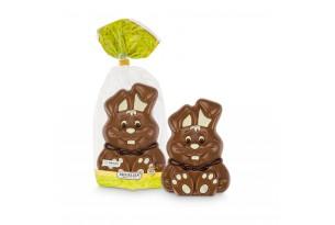 chocri / Riegelein Schokoladen-Osterhase geschminkt mit weißer Schokolade in einer durchsichtigen Verpackung
