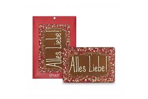 """chocri 400g-Vollmilchschokoladentafel mit handgeschriebenem Schriftzug """"Alles Liebe"""" und bestreute Zutaten in der Verpackung und einzelnd davorstehend"""
