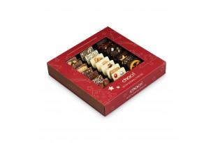 """chocri Minischokoladentafelmix """"Winterweltreise"""" bestreut mit weihnachtlichen Zutaten wie gebrannte Mandeln in der Verpackung"""