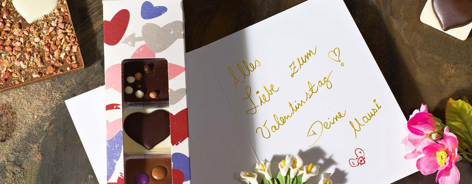 Sprüche, Grüße und Wünsche zum Valentinstag mit Grußkarten und Geschenken aus Schokolade für Dein Valentinchen