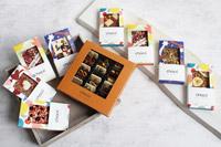 Das neue chocri-Sortiment Tafel-Schokoladen und der Bestseller 'Welttreise' mit 24 handbestreuten Mini-Schokoladen-Tafeln