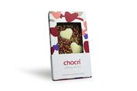 Auch voll verhüllt einfach nur attraktiv: die Tafel 'Herzklopfen' in der neuen Handtaschen-Verpackung 'Liebe'